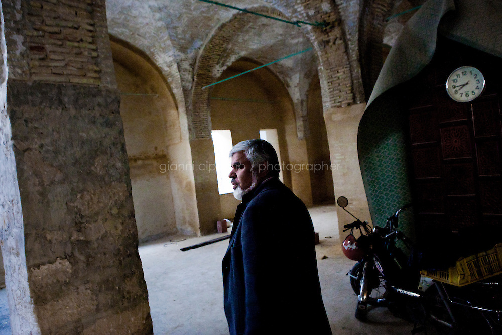 Tunis, Tunisia - 18 December, 2011: Said Ferjani, 57, senior member of the political and communication bureau of the Nahda (Renaissance) party, walks in the Negra mosque (under renovation) where he started his activism when he was 16 years old, in Kairouan, Tunisia on 18 December, 2011. In the 24 October 2011 Tunisian Constituent Assembly election, the first elections since the Tunisian Revolution, the party won 40% of the vote, and 89 of the 217 assembly seats, far more than any other party. Said Ferjani started his activism in the Negra mosque of his hometown Kairouan when he was 16 years old, debating on politics, philosophy, economy and world events. In 1989 former dictator Zine El Abidine Ben Ali turned against Nahda (or Ennahda) and jailed 25,000 activists. Said Ferjani was jailed and tortured. He then flew Tunisia and moved to the UK. He came back to Tunisia after 22 years, after former dictator Ben Ali flew the country.<br /> <br /> Gianni Cipriano for The New York Times