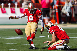 SAN FRANCISCO, CA - OCTOBER 14: Kicker David Akers #2 of the San Francisco 49ers warms up by kicking a field goal off a hold from Andy Lee #4 before the game against the New York Giants at Candlestick Park on October 14, 2012 in San Francisco, California. The New York Giants defeated the San Francisco 49ers 26-3. Photo by Jason O. Watson/Getty Images) *** Local Caption *** David Akers; Andy Lee