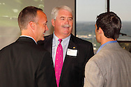 (from left) Jeffery C. Hoagland of the Dayton Development Coalition, Kettering Mayor Don Patterson and Dr. Peter Luongo of Genessa Health Marketing during the Dayton Area Chamber of Commerce Breakfast Briefing at the Dayton Racquet Club in downtown Dayton, Friday, July 13, 2012.