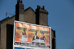 UK ENGLAND LONDON 21APR15 - 'I am an immigrant' pro-immigration billboard poster opposite Queens Park station in West London.<br /> <br /> Poster campaign by Joint Council for the Welfare of Immigrants, funded by crowdfunding and supported by various labour unions.<br /> <br /> jre/Photo by Jiri Rezac<br /> <br /> © Jiri Rezac 2015