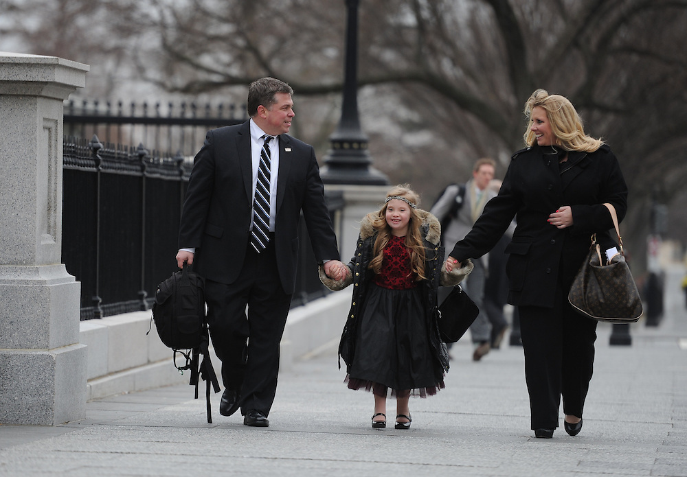 2/10/15 3:11:20 PM -- Washington, DC  -- Rick and Amy Kosmalski of Bear, Del., with daughter Kayla, 8, who has Down Syndrome, walk in Washington, D.C. after a meeting with Vice President Joe Biden.    Photo by H. Darr Beiser, USA TODAY staff ORG XMIT:  HB 132578 DE-ABLE 02/10/2015 (Via OlyDrop)