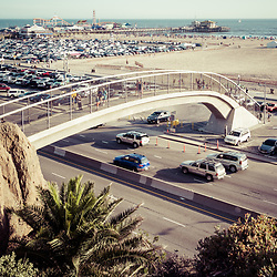 Santa Monica Beach pedestrian bridge and pier vertical photo with Pacific Coast Highway. Copyright ⓒ 2017 Paul Velgos with All Rights Reserved.