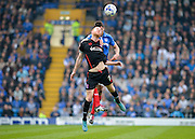 Carlisle United Midfielder Jason Kennedy beats Portsmouth midfielder Danny Hollands in the air during the Sky Bet League 2 match between Portsmouth and Carlisle United at Fratton Park, Portsmouth, England on 2 April 2016. Photo by Adam Rivers.