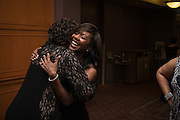 Darlynn Linton, right, hugs former classmate, Melanie Blackwell Marshall, both graduates of Ohio University's class of 1987 during the 2016 Black Alumni Reunion Gala was held at the Baker Center Ballroom on Friday, September 16, 2016.