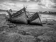 Abandoned boats on the shore of Mull overlooking the Sound of Mull and the Scottish Mainland<br /> <br /> This photograph is a monochramatic version of the view of abandoned boats on the shore of the Isle of Mull. The photograph can be purchased as print, mounted print in frames, canvas or aluminum or as a digital file.