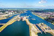 Nederland, Noord-Holland, IJmuiden, 01-08-2016; sluiscomplex IJmuiden met Noordersluis, Middensluis. Parallel aan en rechts van de Noordersluis wordt een nieuwe grote zeesluis gebouwd. Amsterdam aan de horizon.<br /> Lock complex IJmuiden, parallel to the large Northern Lock a new large sea lock will be build.<br /> <br /> luchtfoto (toeslag op standard tarieven);<br /> aerial photo (additional fee required);<br /> copyright foto/photo Siebe Swart