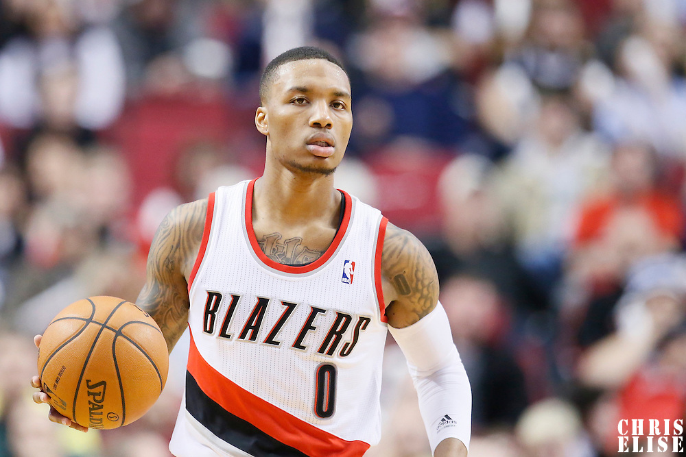 06 December 2013: Portland Trail Blazers point guard Damian Lillard (0) brings the ball upcourt during the Portland Trail Blazers 130-98 victory over the Utah Jazz at the Moda Center, Portland, Oregon, USA.