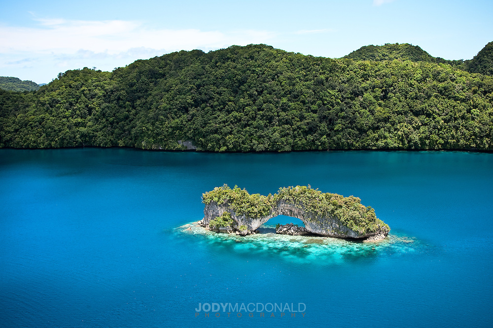 "This untouched photo from a helicopter over Palau shows the intense colors of the famous ""Rock Islands"", specifically the ""Arch""."
