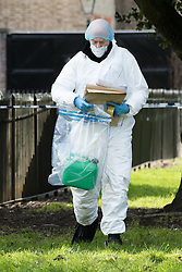© Licensed to London News Pictures. 09/02/2016. London, UK. Police forensic officers working near Kensington Palace in west London, collecting items including a petrol can and personal effects. A man set himself on fire and died after burning to death in the early hours of this morning near Kensington Palace. Photo credit : Vickie Flores/LNP