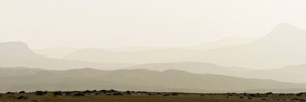 The haze from nearby wildfires creates a painterly look across the ridges of the Owyhee Mountains.