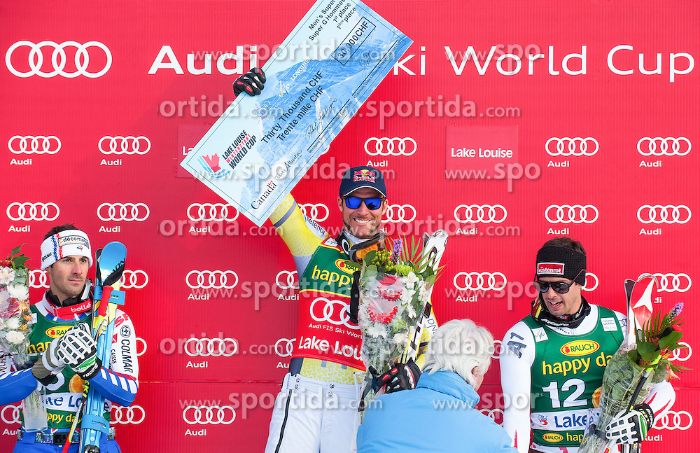 25.11.2012, Lake Louise, CAN, FIS Ski Alpin Weltcup, Lake Louise, SuperG, Herren, im Bild Adrien Theaux of France (L) Aksel Lund Svindal of Norway (C) and Joachim Puchner of Austria // during Mens SuperG of FIS Ski Alpine World Cup at Lake Louise, Canada on 2012/11/25. EXPA Pictures © 2012, PhotoCredit: EXPA/ ESPA/ John Evely
