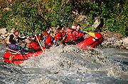 Alaska. Denali NP. Nenana River. Paddle rafts assisted by guide using oars.