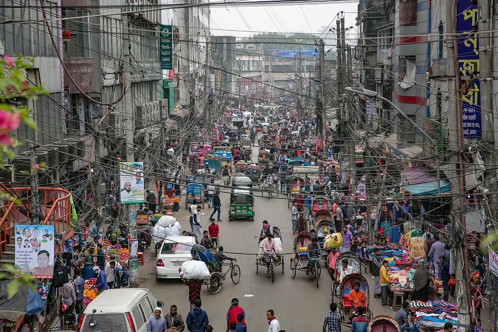 INDIVIDUAL(S) PHOTOGRAPHED: N/A. LOCATION: Dhaka, Bangladesh. CAPTION: Aerial view of a busy street in Dhaka, Bangladesh.