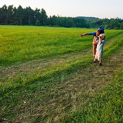 A man and his young son explore a field at Raspberry Farm in Hampton Falls, New Hampshire.