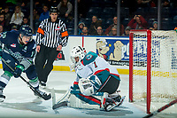 KELOWNA, CANADA - JANUARY 5: Donovan Neuls #19 of the Seattle Thunderbirds tries to put the puck in the net of James Porter #1 of the Kelowna Rockets on January 5, 2017 at Prospera Place in Kelowna, British Columbia, Canada.  (Photo by Marissa Baecker/Shoot the Breeze)  *** Local Caption ***