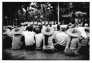 1996: Supporters of the National League of Democracy listen to Aung San Suu Kyi address the crowd in the rain, Rangoon (Yangon), Burma (Myanmar).  Aung San Suu Kyi is now under house arrest.
