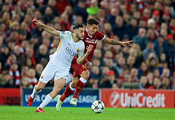 LIVERPOOL, ENGLAND - Tuesday, April 24, 2018: Liverpool's Roberto Firmino and AS Roma's Kostas Manolas during the UEFA Champions League Semi-Final 1st Leg match between Liverpool FC and AS Roma at Anfield. (Pic by David Rawcliffe/Propaganda)