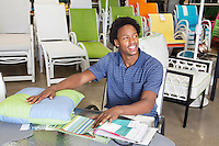 Male African American salesperson working in garden furniture store