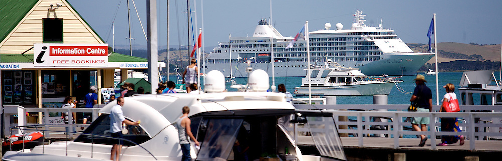 boats & tourists at Russell wharf with cruise ship in background