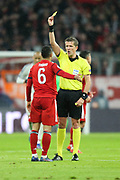 YELLOW CARD Bayern Munich midfielder Thiago Alcantara (6) gets a yellow card during the Champions League match between Bayern Munich and Liverpool at the Allianz Arena, Munich, Germany, on 13 March 2019.