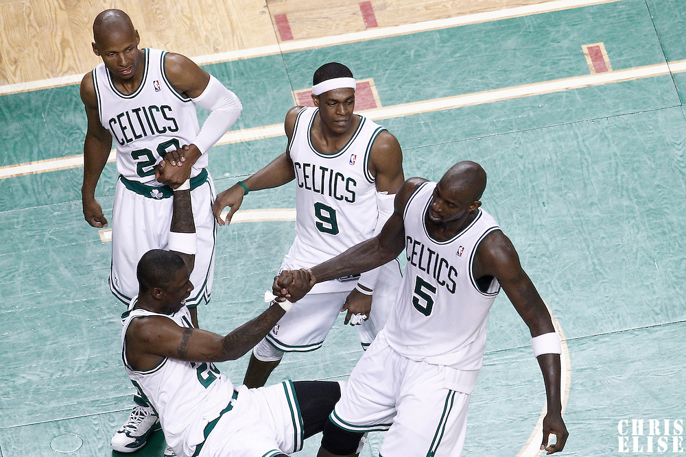 03 June 2012: Boston Celtics shooting guard Ray Allen (20), Boston Celtics point guard Rajon Rondo (9 and Boston Celtics power forward Kevin Garnett (5) help Boston Celtics small forward Mickael Pietrus (28) to stand up during the Boston Celtics 93-91 overtime victory over the Miami Heat, in Game 4 of the Eastern Conference Finals playoff series, at the TD Banknorth Garden, Boston, Massachusetts, USA.