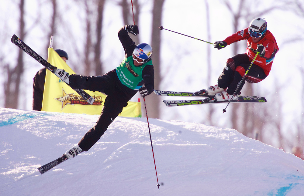 -20110211- Collingwood, Ontario,Canada -- Tomas Kraus, left, of the Czech Republic leads's Canada's Christopher Delbosco during the semi final of the Rockstar Ski Cross Grand Prix race at Blue Mountain in Collingwood, Ontario, February 11, 2011.<br /> AFP PHOTO/Geoff Robins