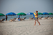 Lifeguards set up Beach umbrellas on the beach in Myrtle Beach, SC.