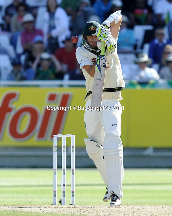 Nathan Lyon of Australia defends as ball goes past his head. South Africa v Australia, first test, day 2, Newlands, South Africa. 10 November 2011<br /> <br /> <br /> &copy;Ryan Wilkisky/BackpagePix
