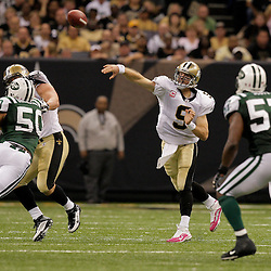 2009 October 04: New Orleans Saints quarterback Drew Brees (9) throws a pass during a 24-10 win by the New Orleans Saints over the New York Jets at the Louisiana Superdome in New Orleans, Louisiana.