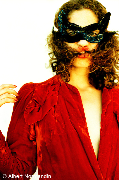 Woman in red with black mask
