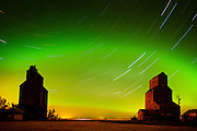 Grain elevator in ghost town with northern lights in the northern sky<br /> Lepine<br /> Saskatchewan<br /> Canada