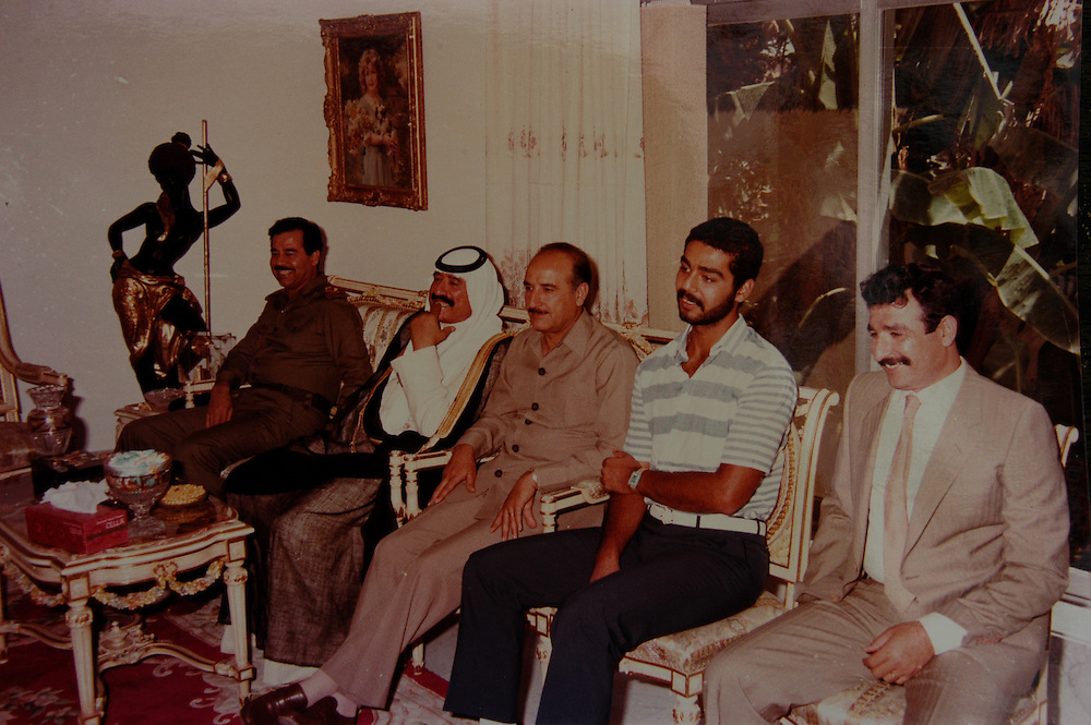 A family photo of Saddam Kamel (right), Saddam Hussein's son-in-law, Uday, Saddam Hussein and other family members. Saddam Kamel and his brother Hussein, both married to Saddam's daughters, were killed by Saddam when they returned to Iraq after fleeing to Jordan with their families..Baghdad, Iraq. 30 May 2003..Photo © J.B. Russell