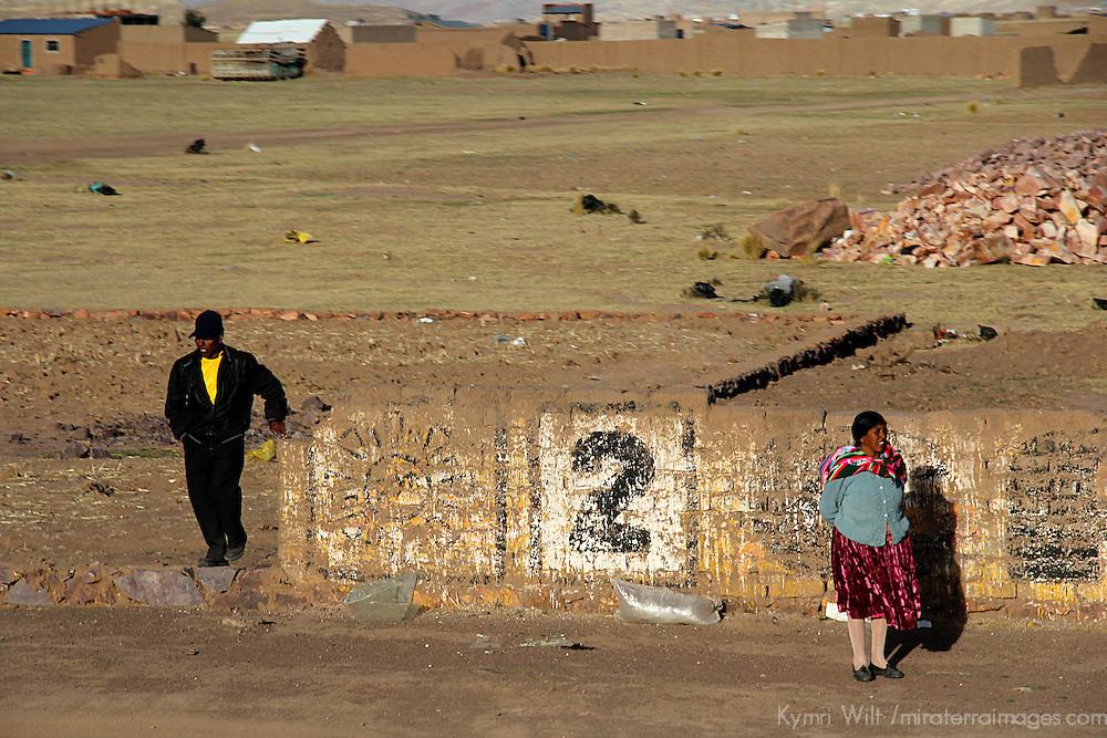 South AMerica, Peru, Juliaca. Villagers at the roadside.