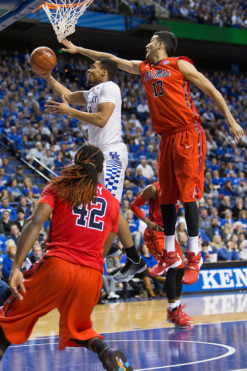Kentucky guard Isaiah Briscoe, center, drives to the basket in the second half. The University of Kentucky hosted Ole Miss, Saturday, Jan. 02, 2016 at Rupp Arena in Lexington.