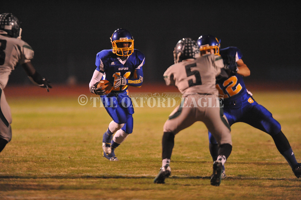 Oxford High's Glenn Gordon (11) runs 17 yards for a touchdown behind the block of Oxford High's Ethan Holmes (12) on Vicksburg's Kedarian Wells (5) in MHSAA Class 5A playoff action in Oxford, Miss. on Friday, November 15, 2013. Oxford won 50-7.