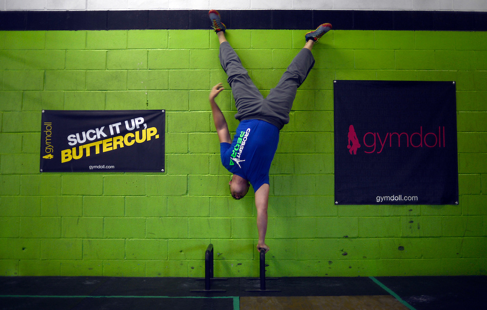 CrossFit Peoria owner Nathan Palkovic works on a one-handed balancing exercise.