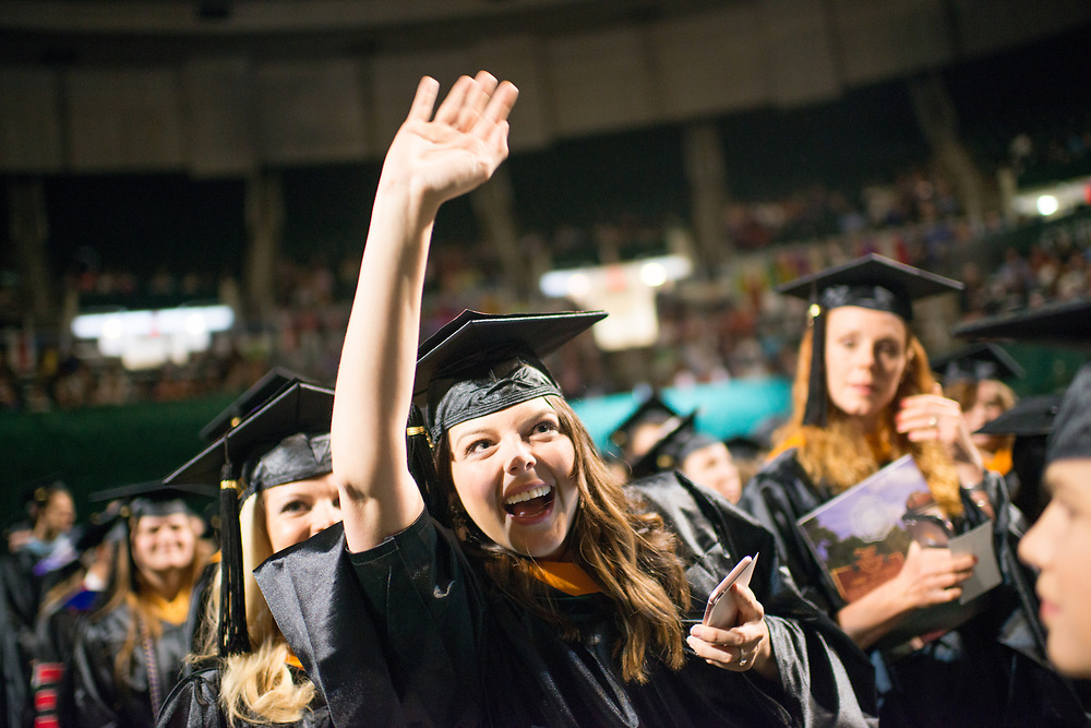 Catherine Shay Collins- Wagner waves to supporters at graduate commencement. Photo by Ben Siegel