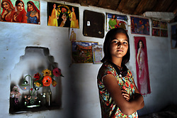 Sunil Nayak, 13, is seen inside her bedroom at her home in rural Rajasthan, India on April 30, 2009. Nayak refused a marriage the year before when her teenage sisters were all married. The night before the ceremony, Nayak's mother tied a string around her wrist and told her she was also to be married. However, Nayak refused and even threatened violence should she be forced.