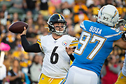 Pittsburgh Steelers quarterback Devlin Hodges passes under pressure from Los Angeles Chargers defensive end Joey Bosa (97) during an NFL football game against the Los Angeles Chargers. The Steeler beat the Chargers 24-17 on Sunday, Oct. 13, 2019, in Carson, Calif. (Ed Ruvalcaba/Image of Sport)