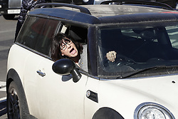 © Licensed to London News Pictures. 25/02/2019. London, UK. Minister of State at the Department for Business, Energy and Industrial Strategy Claire Perry shouts at police from her car at Carriage Gate, outside Parliament, as they refuse to let her drive in the exit gate. Photo credit: Peter Macdiarmid/LNP