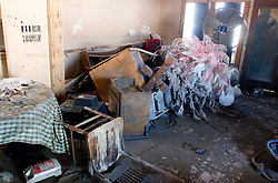 25 Oct,  2005. New Orleans, Louisiana. Hurricane Katrina aftermath.<br /> The 8th ward lies in ruins following Katrina's devastating floods. Inside the remains of what was once the home of a Mardi Gras Indian, the fabulous feathered costume trashed by the water.<br /> Photo; ©Charlie Varley/varleypix.com