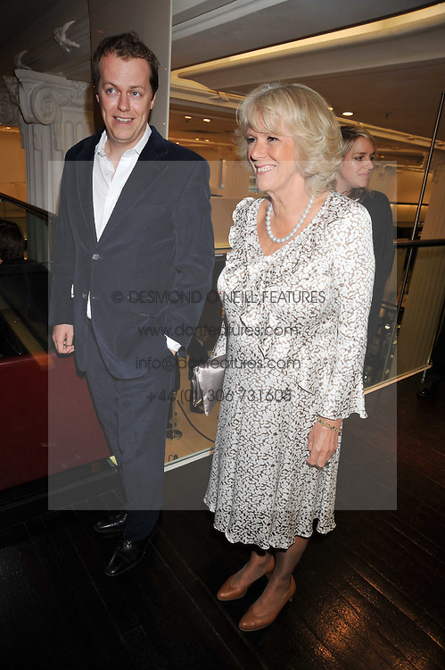 HRH the DUCHESS OF CORNWALL and her son TOM PARKER BOWLES at the launch of Tom Parker Bowles's new book 'Full English' held in the Gallery Restaurant, Selfridges, Oxford Street, London on 9th September 2009.