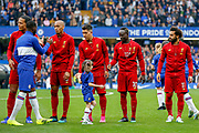 Liverpool players shake hands with the Chelsea players before the Premier League match between Chelsea and Liverpool at Stamford Bridge, London, England on 22 September 2019.