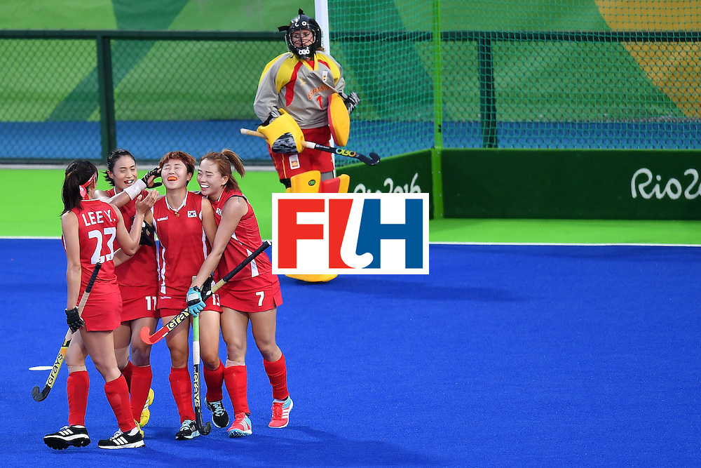 South Korea's Cheon Eunbi celebrates scoring with her team-mates during the women's field hockey South Korea vs Spain match of the Rio 2016 Olympics Games at the Olympic Hockey Centre in Rio de Janeiro on August, 13 2016. / AFP / MANAN VATSYAYANA        (Photo credit should read MANAN VATSYAYANA/AFP/Getty Images)