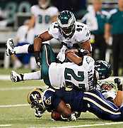 ST. LOUIS, MO - SEPTEMBER 11:   Asante Samuel #22 and Jarrad Page #41 of the Philadelphia Eagles tackles Carnell Williams #33 of the St. Louis Rams at the Edward Jones Dome on September 11, 2011 in St. Louis, Missouri.  The Eagles defeated the Rams 31 to 13.  (Photo by Wesley Hitt/Getty Images) *** Local Caption *** Asante Samuel; Jarrad Page; Carnell Williams