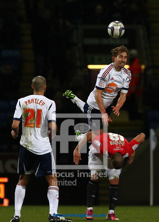 Picture by John Rainford/Focus Images Ltd +44 7506 538356.02/04/2013.Craig Dawson of Bolton Wanderers goes over the back of James Vaughan of Huddersfield Town during the npower Championship match at the Reebok Stadium, Bolton.