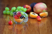 Freshly cut fruit salad with apple, grapes, peaches and cherries