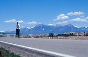 Skater, Matt Fowler, on a road in the desert, USA 2005