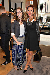 Left to right, TANIA FARES and HEATHER KERZNER at a lunch hosted by Alice Naylor-Leyland and Tamara Beckwith in celebration of the Coach 2015 collection held at Coach, New Bond Street, London on 18th September 2014.