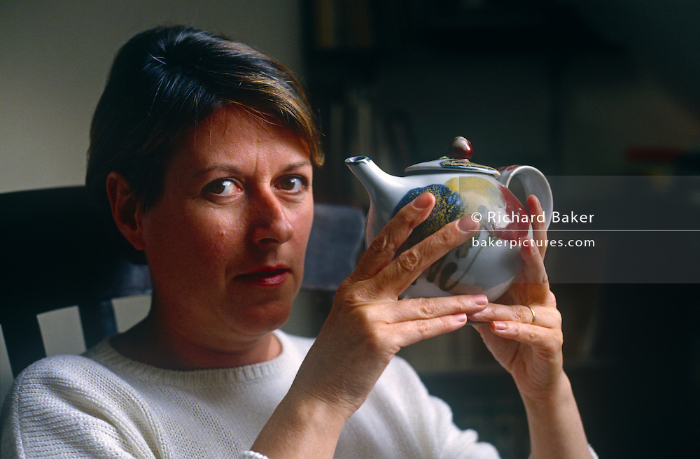 A portrait of ceramicist Janice Tchalenko at home in April 1987 at her home in south London, UK. Janice Tchalenko (1942-) was born in Rugby, Warwickshire. She is a ceramic artist best known for her success in translating decorative studio pottery into designs for batch and large-scale production.